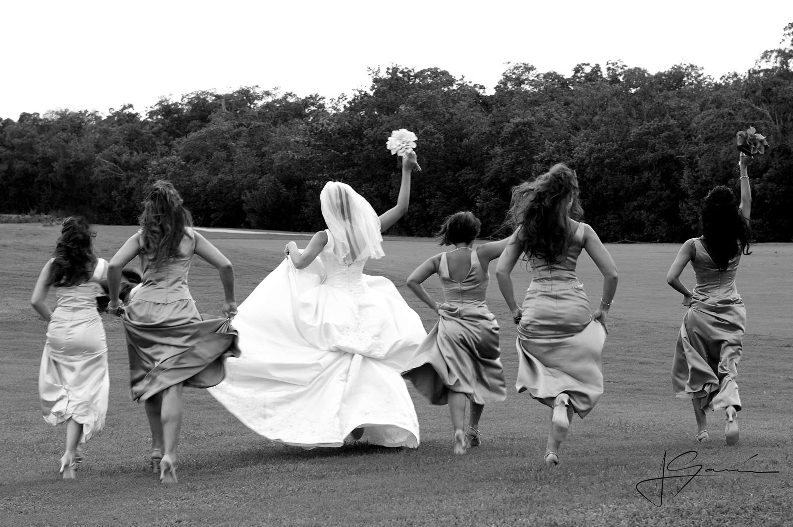 Funny Bride with Bridesmaids Running on Grass - Black & White