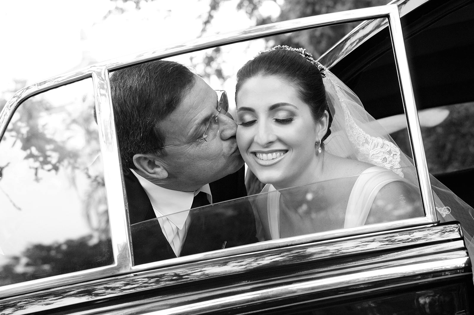 Happy Father of the Bride Kissing Her in Classic Car - Black and White
