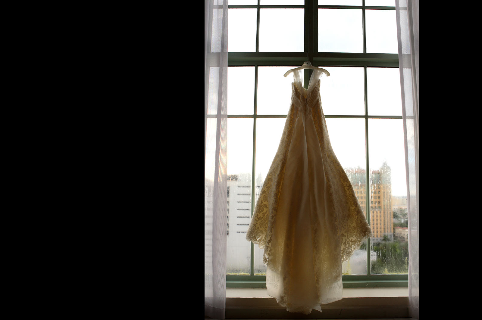 Bride Dress Hanging from Window - Photo by J. Garcia