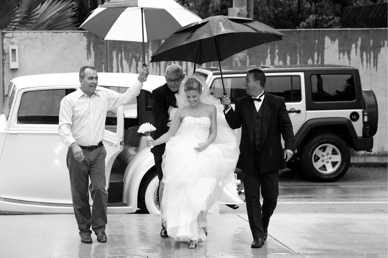 Smiling Bride Walking Under the Rain with Father