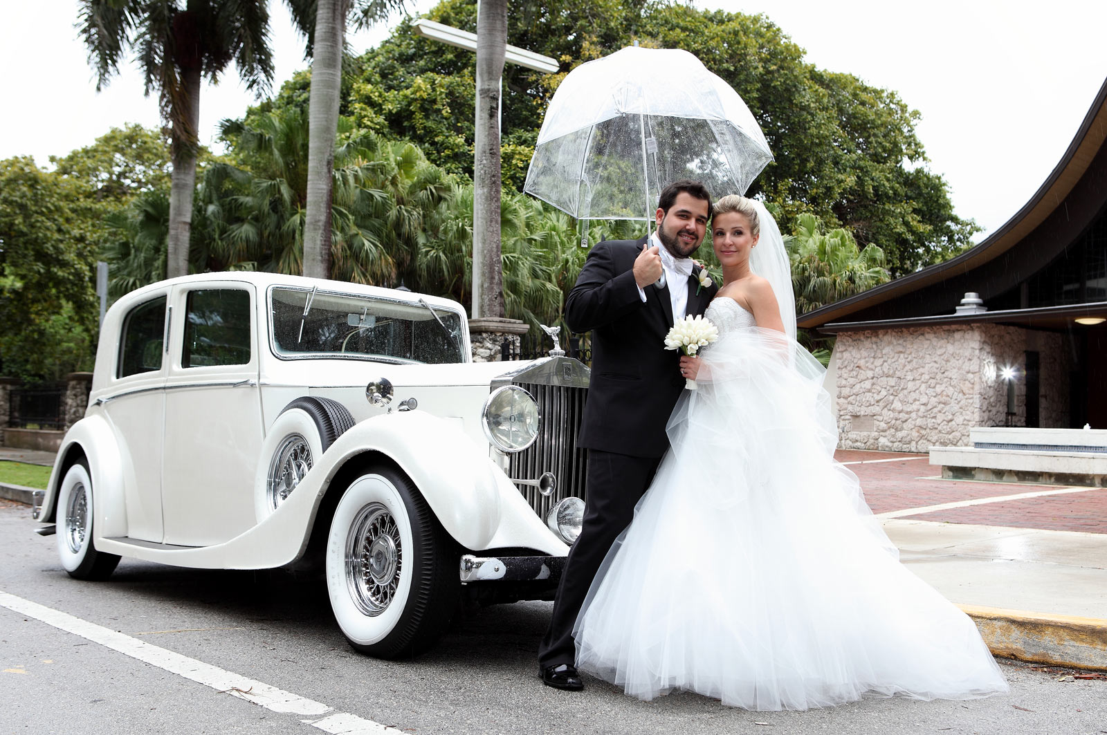 Happy Wedding Couple Under the Rain - Classic Car