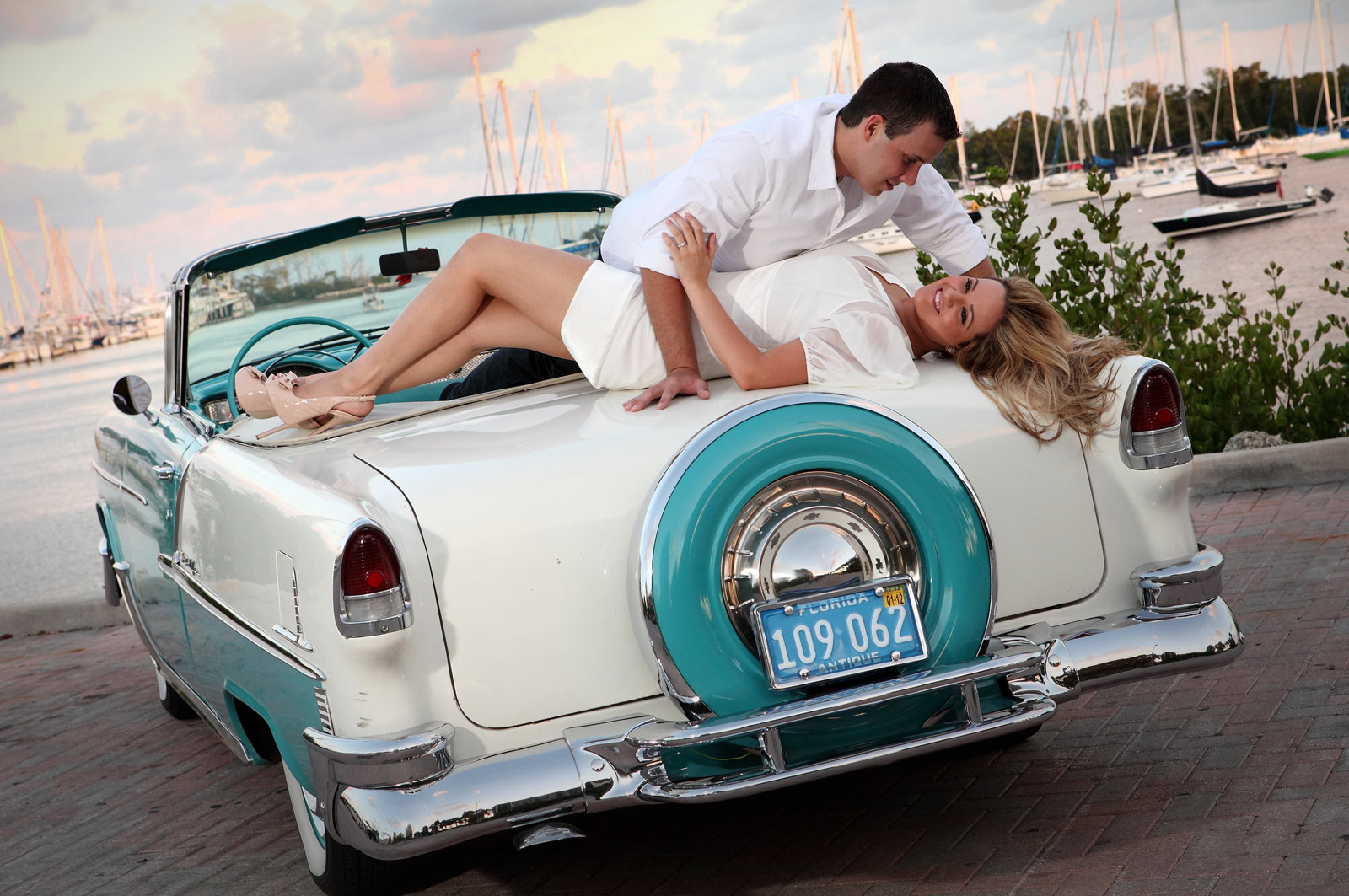 Romantic Engagement Session on Top of White and Blue Classic Car